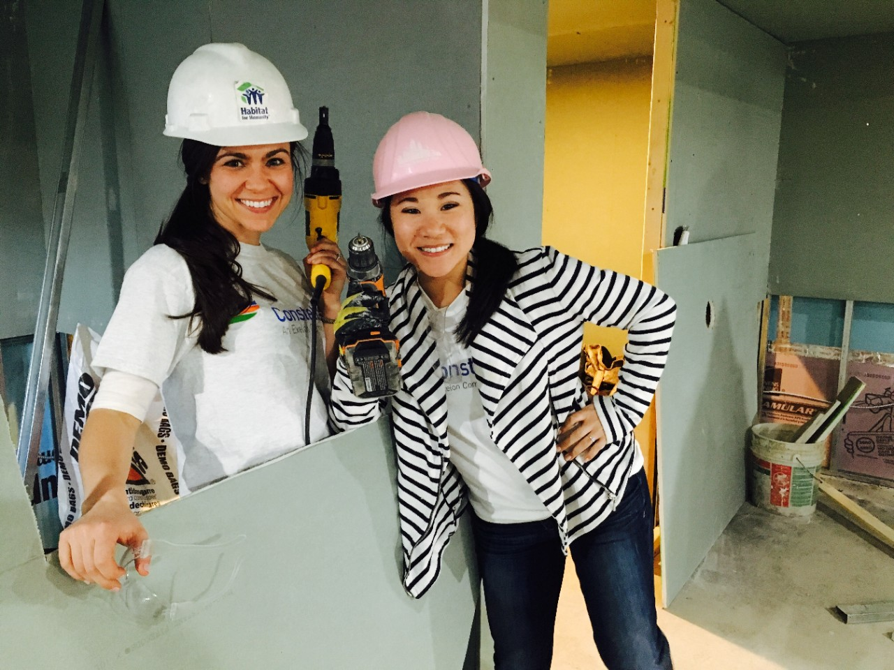 Constellation employees working with Habitat for Humanity